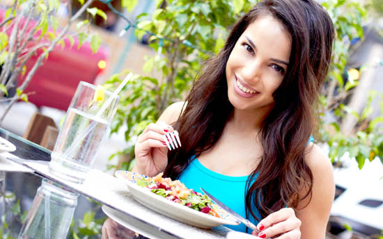 Young Attractive Woman Eating Salad